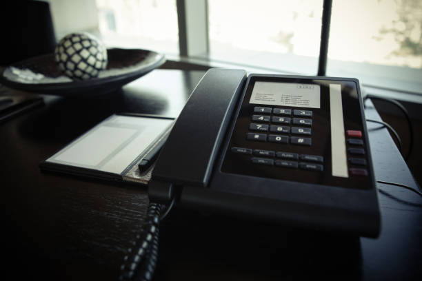 hotel room service telephone and notepad on the table